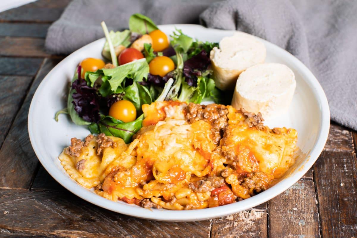 plate with ravioli and salad