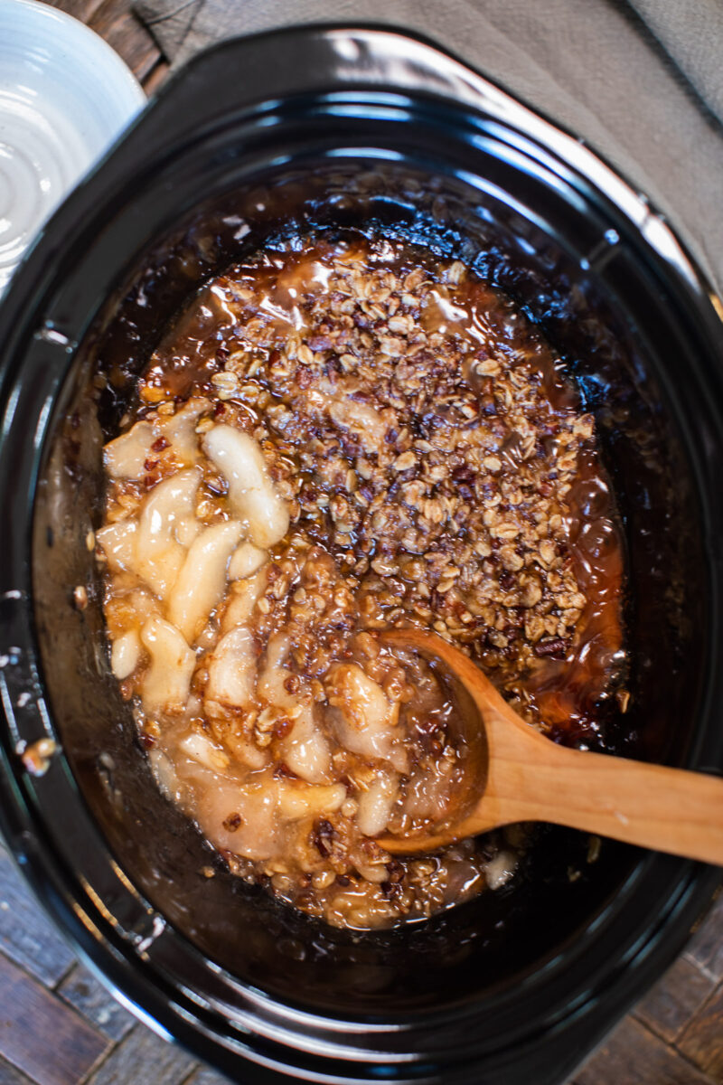 apple crisp done cooking with spoon in it