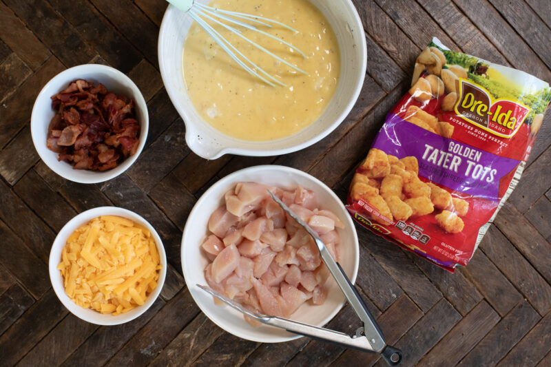 ingredients for chicken tater tot casserole on wooden table