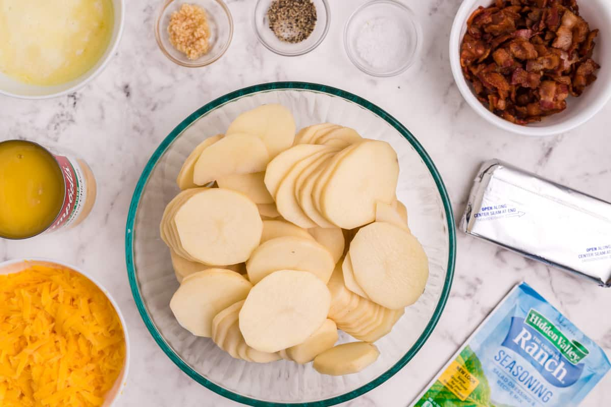 sliced potatoes and other ingredients for crack potatoes
