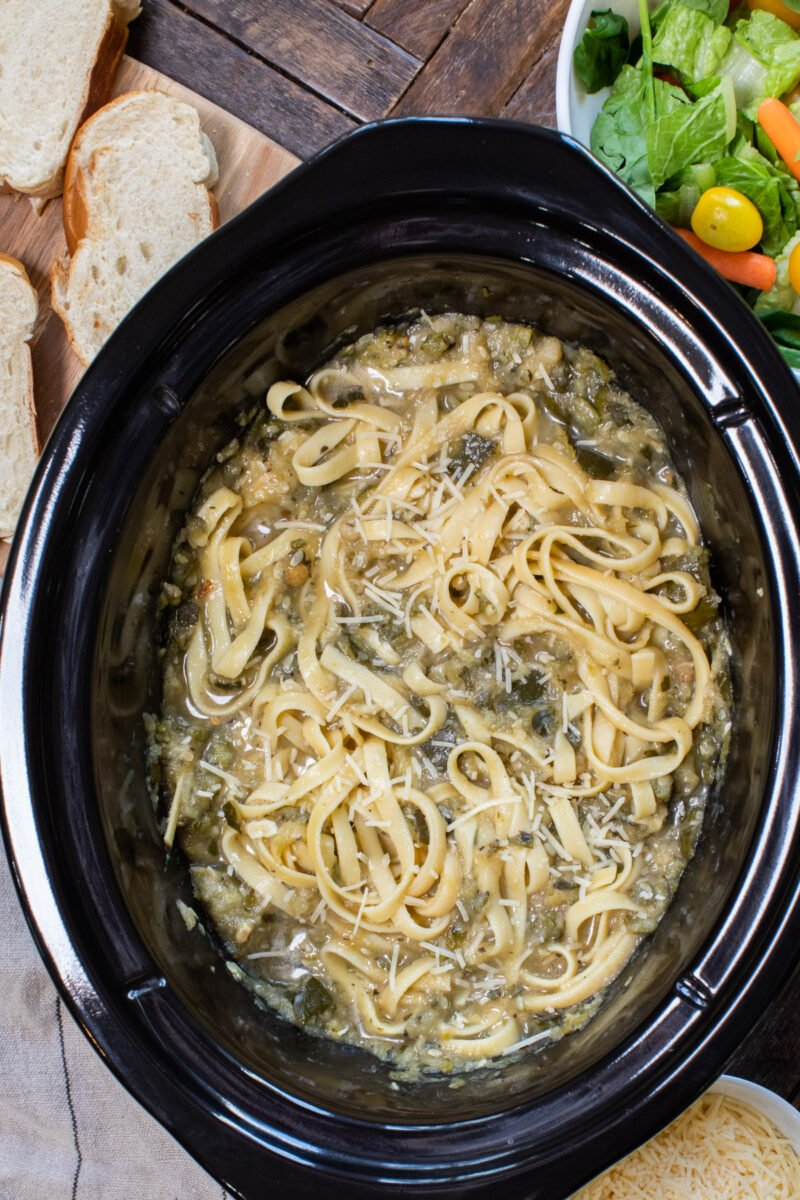 fettuccine with bolognese sauce mixed in, in slow cooker.