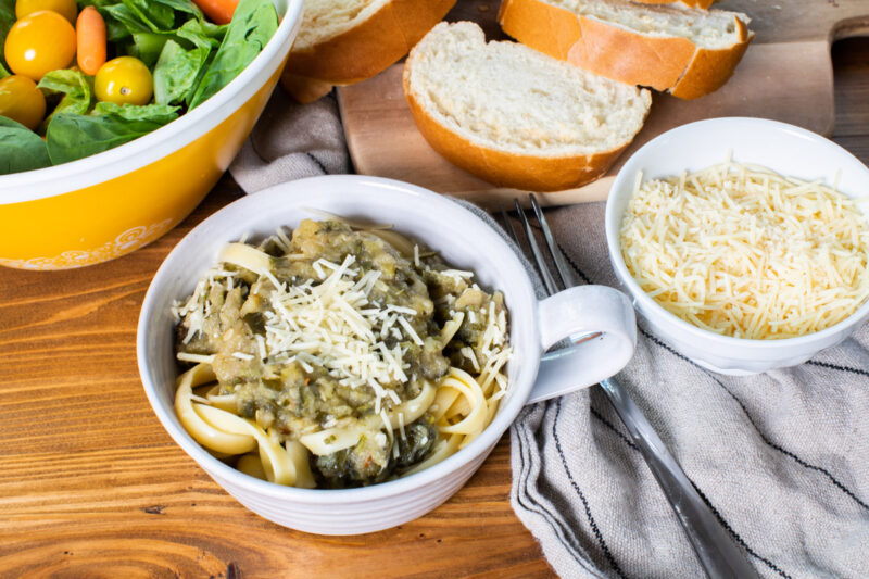 fettuccine with zucchini bolognese on top in bowl