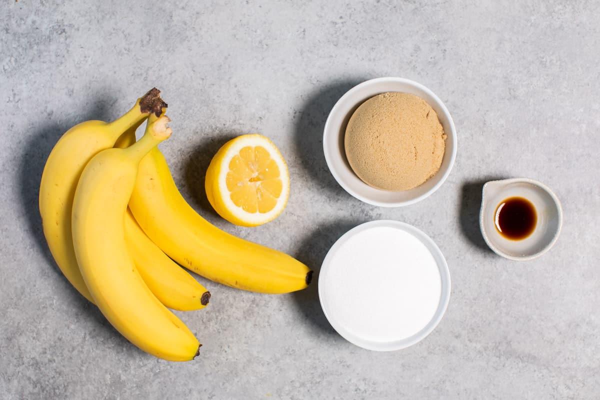 bananas, sugar, lemon and vanilla on table