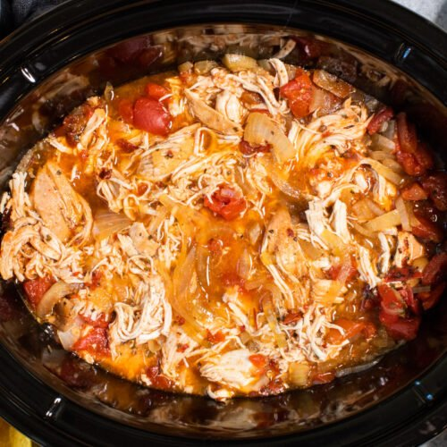 close up of shredded chicken tinga in slow cooker