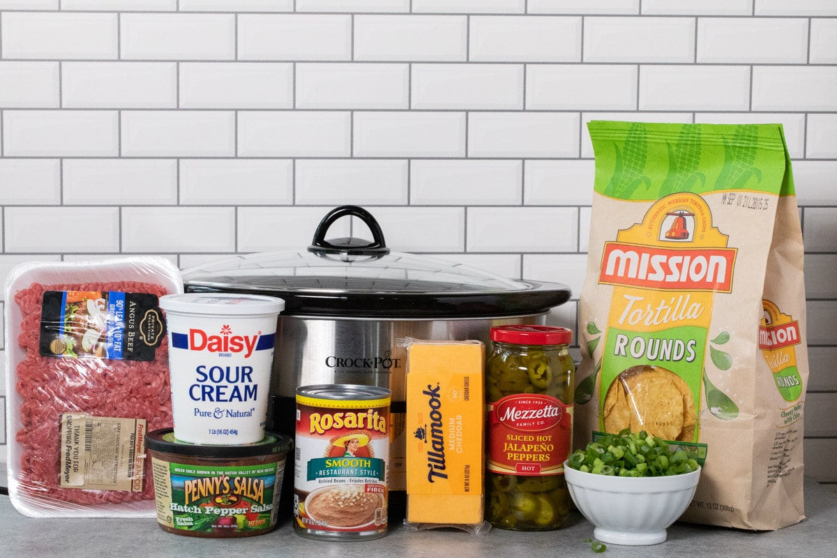 ingredients for 7 layer bean dip in front of slow cooker