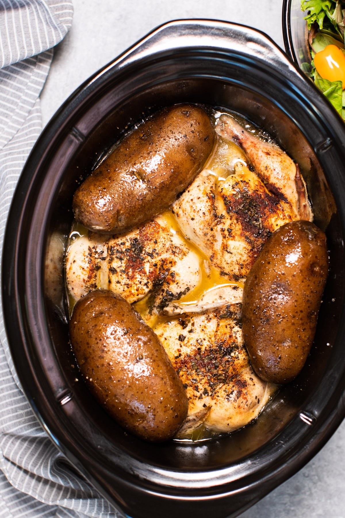 3 game hens and 3 russet potatoes, done cooking in a slow cooker