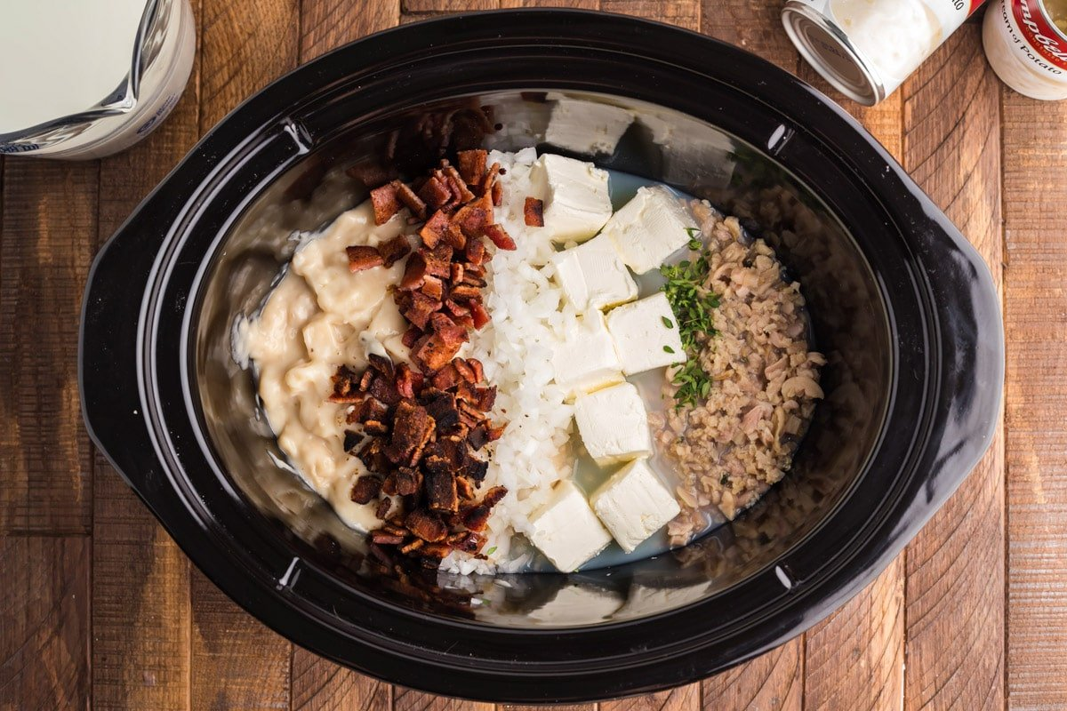 ingredients for clam chowder neatly organized in slow cooker