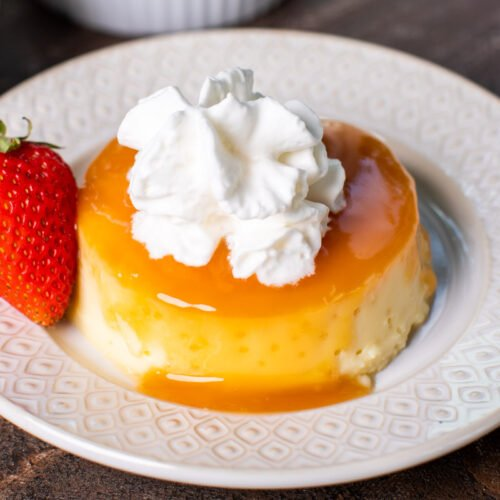 close up image of flan with whipped cream