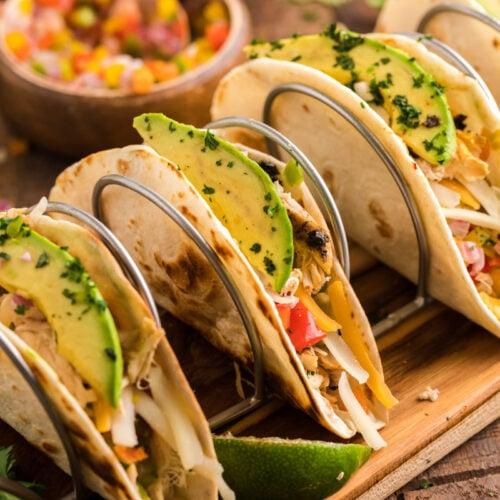 4 fajitas on a taco tray