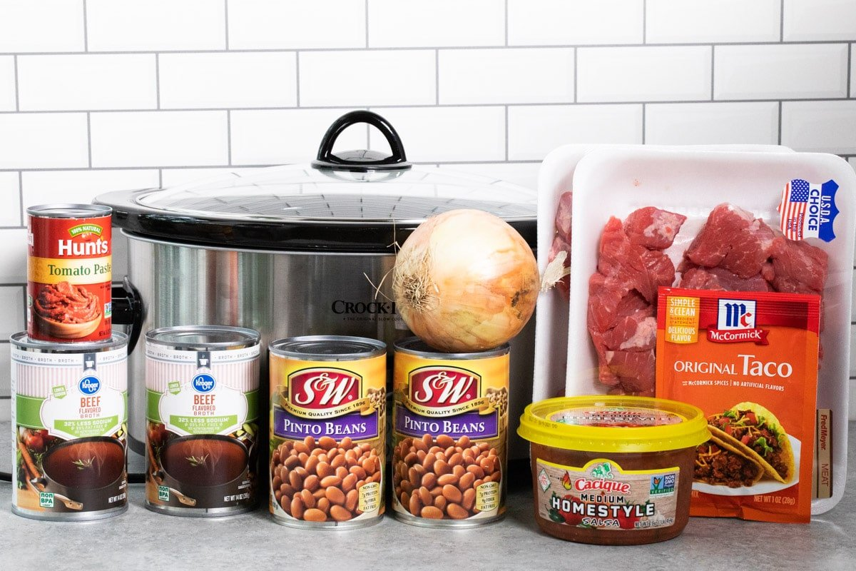 ingredients for steakhouse chili in front of a slow cooker