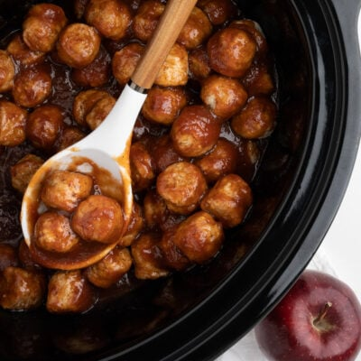 close up of apple butter meatballs in slow cooker
