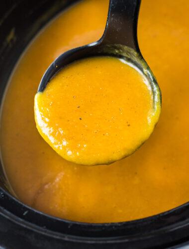 butternut squash in black ladle