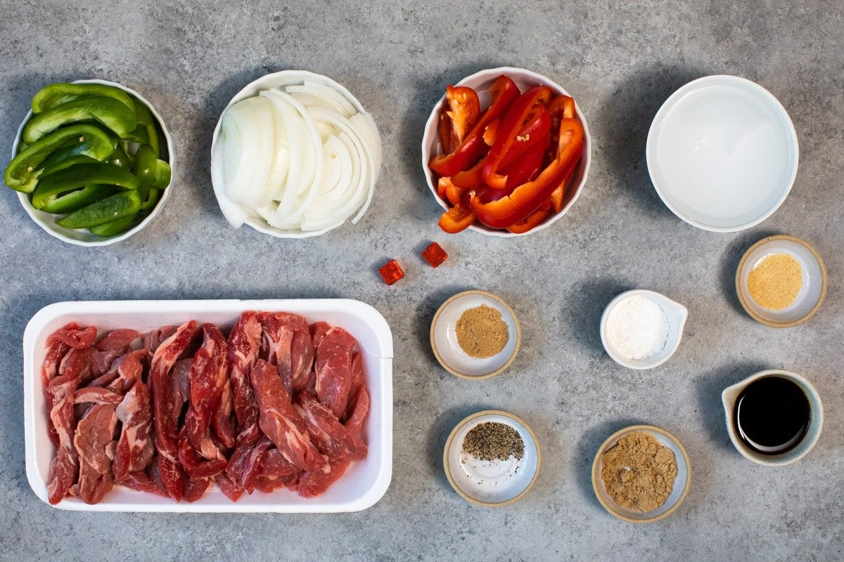 ingredients for pepper steak on a table